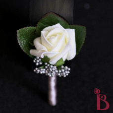 gray wedding boutonniere with ivory rose bud and gray berries