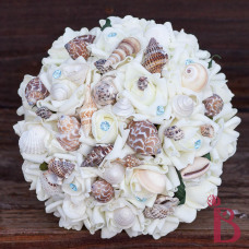 Light blue seashell bouquet with real seashells some dark brown some light brown and with sea blue pins