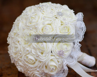 ivory wedding bouquet with pearls and lace