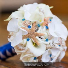 star fish sea shells wedding bouquet orchids calla lilies and roses with royal blue pins