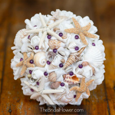 top view of wedding bouquet with plum pins