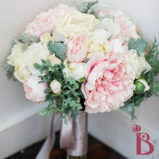 pastel silk wedding bouquet with peonies roses anemones and dusty miller leaves