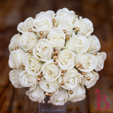vintage vibe top view wedding bouquet ivory rosebuds with old gold pearl accents between