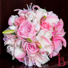 pink tropical bouquet with lilies roses tulips calla lilies onion grass