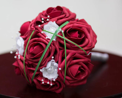 flower girl bouquet red roses white pearl flowers strands of grass and gray handle
