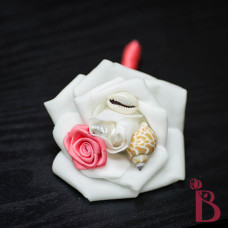 seashell wedding boutonniere with coral rosette small shells and cream rose