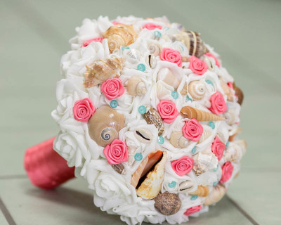 coral tiffany blue aqua wedding bouquet seashells and roses with coral rosettes and aqua pins and small shell for wedding beach or destination weddings