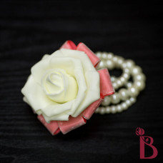 cream rose wrist corsage with coral ribbons for beach weddings prom on pearl bracelet