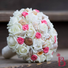 coral wedding bouquet with rosettes and cream roses
