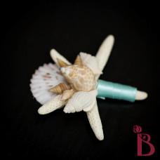 wedding boutonniere with seashells starfish aqua ribbon